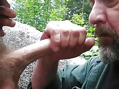 Older guy has fun sucking a younger guys cock in the park
