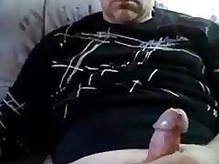 Stocky guy jerking off
