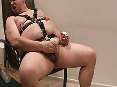 Bi Chub in leather harness jacking off with music and toys