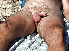 Hairy Daddy cumming on the beach