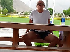 Horny older man shows his cock on Public Park Bench.